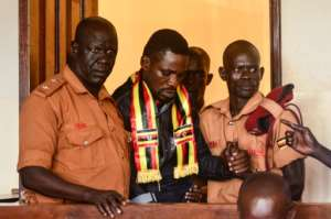 Wearing a scarf with the Ugandan colours, Kyagulanyi appeared last week at the chief magistrate court in Gulu, northern Uganda to face treason charges.  By STRINGER (AFP)