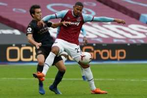 West Ham United forward Sebastien Haller (R) has received a first call-up for the Ivory Coast..  By PAUL CHILDS (POOL/AFP)