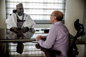 When he is not fulfilling his role as the Sarkin Fulani of Lagos, Mohammed Abubakar Bambado is a businessman, here meeting with a partner at his office in Apapa district.  By Luis TATO (AFP)
