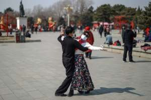 While the crisis deepens in much of the world, some in China are returning to a normalcy of sorts.  By STR (AFP)