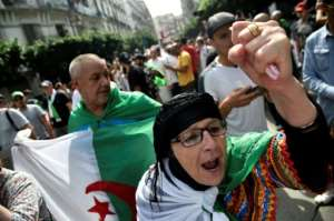 While Algeria's army was key to Bouteflika's downfall his departure brought the military in direct confrontation with the Hirak protest movement.  By RYAD KRAMDI (AFP/File)