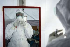 While some are seemingly oblivious to the dangers of the virus, others are increasingly suspicious.  By Isaac Kasamani (AFP/File)