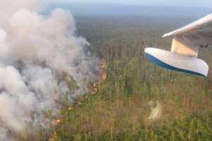 Wild fires unprecedented in scope and intensity burned across parts of Siberia in July.  By HO (press-service of Russia's Krasnoyarsk Krai's forestry ministry/AFP)