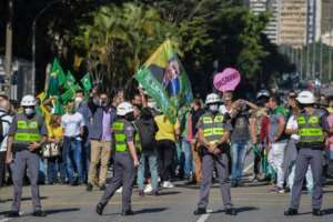 With more than half a million known infections, Brazil has the second-highest caseload in the world, but President Jair Bolsonaro again defied social distancing recommendations to meet supporters.  By Nelson ALMEIDA (AFP)