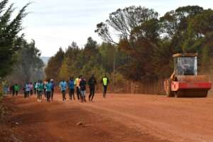 With athletics facilities either closed or under construction, Kenyan athletes train along a dirt road at Iten, a town world-famous for its high-altitude training at 2,400 metres (7,874 feet) above sea level.  By TONY KARUMBA (AFP)