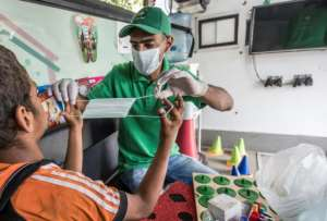 With the financial crunch caused by the COVID-19 pandemic, some charities have concentrated efforts on health and sanitation to help children protect themselves against the disease.  By Khaled DESOUKI (AFP)