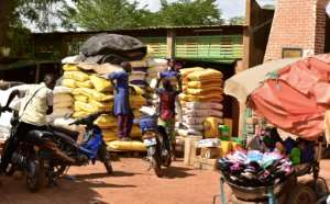 With the lack of work in Burkina's north, many people say they are struggling to feed their families.  By ISSOUF SANOGO (AFP/File)