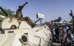 Witnesses said troops had stationed several vehicles loaded with machine-guns at the gates of the complex.  By - (AFP)