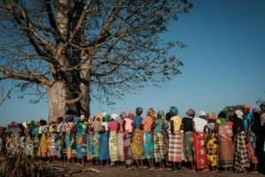 Women wait in line for emergency supplies in Estaquinha, Mozambique.  By Yasuyoshi CHIBA (AFP)