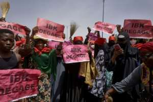 Women wearing veils gather for protest.  By MICHELE CATTANI (AFP)