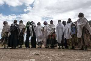 Women gather to mourn the victims of a massacre allegedly perpetrated by Eritrean soldiers in the village of Dengolat, north of Mekele, in February 2021.  By EDUARDO SOTERAS (AFP/File)