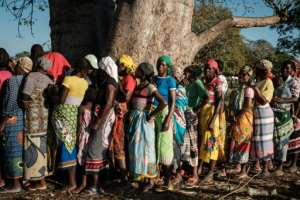 Women lined up for relief in Estaquinha, some 80 kilometres from Beira. By Yasuyoshi CHIBA (AFP)