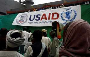 Workers offload US aid destined for South Sudan from the World Food Programme (WFP) at Port Sudan on March 19, 2017: the United States warned it was considering cutting off aid to South Sudan unless its