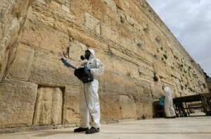 Workers sanitise the Western Wall, the most holy site where Jews can pray against the spread of the coronavirus COVID-19 in Jerusalem..  By Emmanuel DUNAND (AFP)