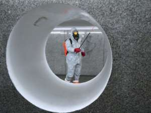 Workers wearing protective suits spray disinfectant at a subway station in Warsaw.  By JANEK SKARZYNSKI (AFP/File)