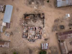 Wrecked and burned homes at Angwan Aku. The conflict in Nigeria's Middle Belt has been sharpened by religion -- Fulani herders are mainly Muslim and the sedentary farmers are predominantly Christian.  By Florian PLAUCHEUR (AFP)