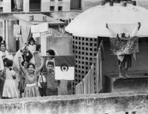 Young Algerians celebrate the anniversary of the beginning of the war of independence on an Algiers rooftop on November 1, 1961.  By JEAN-CLAUDE COMBRISSON, STF (AFP/File)
