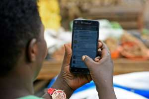 Zambia unveiled a tax on calls made over the internet with apps like WhatsApp, sparking an outcry the move will stifle freedom of expression.  By Isaac Kasamani (AFP/File)