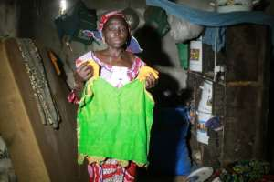 Zainabu Mala holds a shirt belonging to her daughter Kabu who was abducted. By Audu Ali MARTE (AFP)