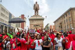Zimbabwe opposition supporters gather a National Electoral Reform (NERA) coalition march through Bulawayo, on September 17, 2016