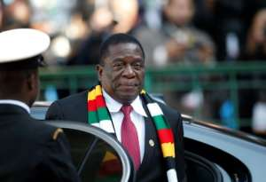 Zimbabwe President Emmerson Mnangagwa campaigned in last year's elections vowing to revive Zimbabwe's sickly economy.  By SIPHIWE SIBEKO (POOL/AFP/File)