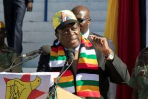 Zimbabwean President Emmerson Mnangagwa is the favourite to win elections on July 30..  By Wilfred Kajese (AFP)