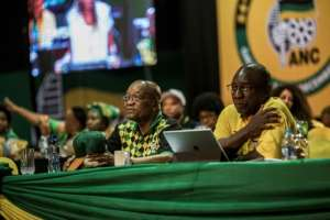 Zuma (left) and Ramaphosa pictured at last month's ANC congress, where Ramaphosa replaced his boss as party chief.  By GULSHAN KHAN (AFP)