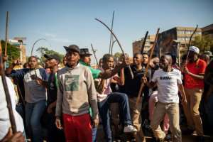 Zulu residents of the Jeppe Men Hostel in Johannesburg took to the streets of the city's business district in Tuesday's disturbances.  By Michele Spatari (AFP)