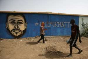 A mural on the wall of a north Khartoum youth club commemorates Mohamed Mattar, one of dozens of demonstrators killed in a June 3 raid on a longunning protest camp outside army headquarters.  By ASHRAF SHAZLY (AFP/File)
