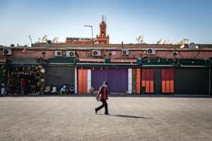 A man walks by mostly-closed stalls at the Jemaa el-Fna square in the Moroccan city of Marrakesh on September 8, 2020.  By FADEL SENNA (AFP)