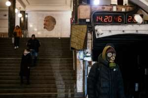 A man wearing a gas mask waits on the platform at the Biblioteka Imeni Lenina metro station in Moscow.  By Dimitar DILKOFF (AFP)
