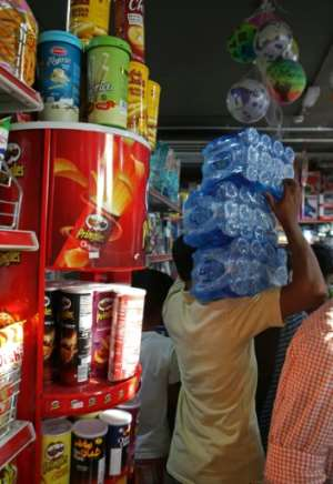 A man buys water at a shop in Doha, on June 5, 2017