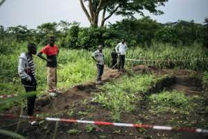 A mass grave allegedly containing nearly 100 bodies was discovered in Bongende, the worst-hit of four villages in Yumbi. By ALEXIS HUGUET (AFP)