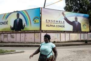 A massive Conde billboard in capital Conakry.  By JOHN WESSELS (AFP)