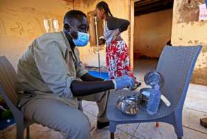 A medic disinfects tools at a medical facility in Um Raquba, a camp that has been set up for Ethiopian refugees in eastern Sudan.  By ASHRAF SHAZLY (AFP)