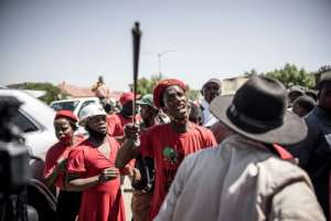 A member of the Economic Freedom Fighters confronts farmers in Senekal.  By MARCO LONGARI (AFP)