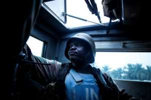 A member of MONUSCO, the UN's largest peacekeeping force, in the DRC town of Oicha.  By JOHN WESSELS (AFP)