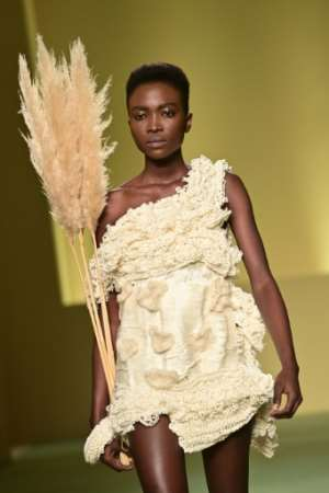 A model presents a creation by Cameroonian fashion stylist Claudia Gisele Ntsama from the collective