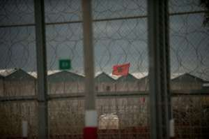 A Moroccan flag flies behind the border fence between Morocco and Spain's North African territory of Ceuta