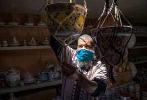 A Moroccan potter displays his handicrafts at a shop in the city of Sale.  By FADEL SENNA (AFP)
