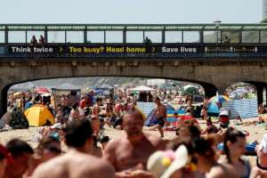 A busy beach in Bournemouth, Britain, where government advisors have warned the country's lockdown was being lifted too quickly.  By Adrian DENNIS (AFP)