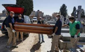 A burial in Spain, which along with Italy accounts for more than half of the world's coronavirus deaths.  By BALDESCA SAMPER (AFP)