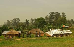 A Bangladeshi patrol from the United Nations mission in DR Congo passes Congolese soldiers in Ituri