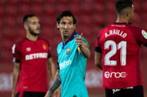 A beardless Lionel Messi returned to the football pitch with a goal and two assists as Barcelona thumped Real Mallorca.  By JAIME REINA (AFP)