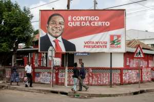 A billboard in Xai-Xai for President Filipe Nyusi, who is running for his second term in office in Tuesday's election.  By GIANLUIGI GUERCIA (AFP)
