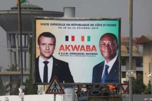 A billboard in Abidjan depicting French President Emmanuel Macron and Ivorian President Alassane Ouattara -- 'Akwaba' means 'Welcome'.  By Ludovic MARIN (AFP)