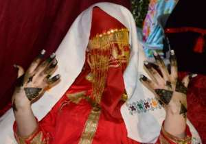 A bride shows her henna-painted hands, the day before her wedding in Gabes, Tunisia.  By MOURAD MJAIED (AFP)