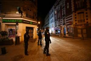 A curfew was imposed in some areas of France with police patrolling the streets.  By FRANCK FIFE (AFP)