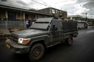 A Cameroonian Army armoured vehicle patrols the streets of the majority English-speaking Southwest province capital of Buea, a region in the grip of an armed revolt by anglophones demanding independence from the majority French-speaking country.  By MARCO LONGARI (AFP/File)