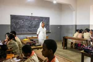 A Catholic nun teaches at a class at St. John's high school. Many Muslim parents in Madagascar speak highly of the quality of education in Catholic schools and say they are unfazed by the Christian component of the curriculum.  By Fita Fanomezantsoa (AFP)